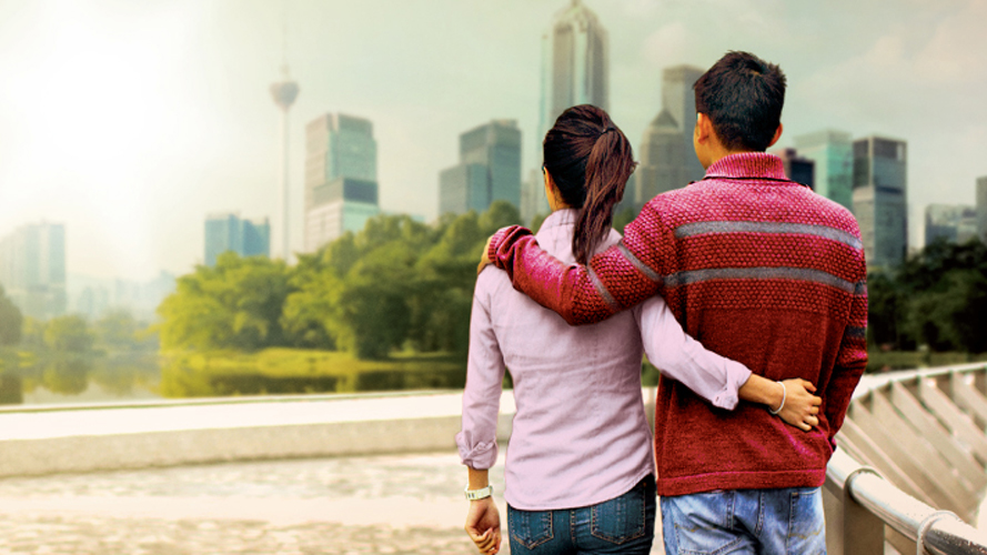 Man and woman looking out at view of city skyline; image used for HSBC Amanah Personal Financing-i.