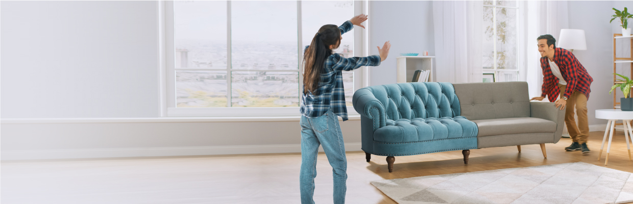Couple moving couch; image used for HSBC Amanah card instalment plan mastercard page.